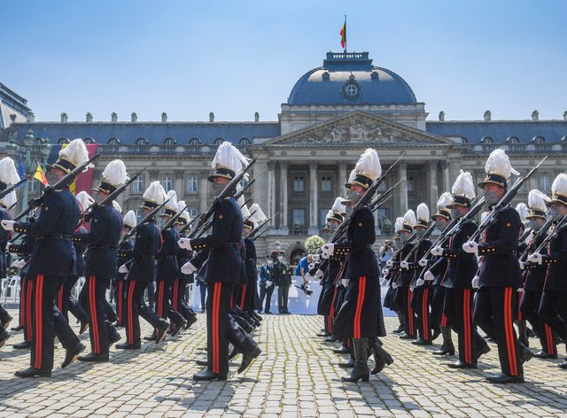 Belgium's Crown Princess Elisabeth marches with cadets of the military school as they march by the royal tribune during the National Day parade in Brussels (Laurie Dieffembacq/AP)
