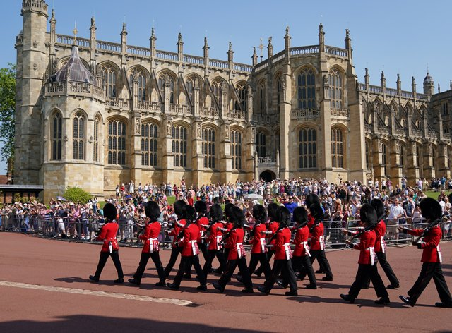 Members of the 1st Battalion Grenadier Guards arrive for the Changing of the Guard at Windsor Castle in Berkshire (Andrew Matthews/PA)