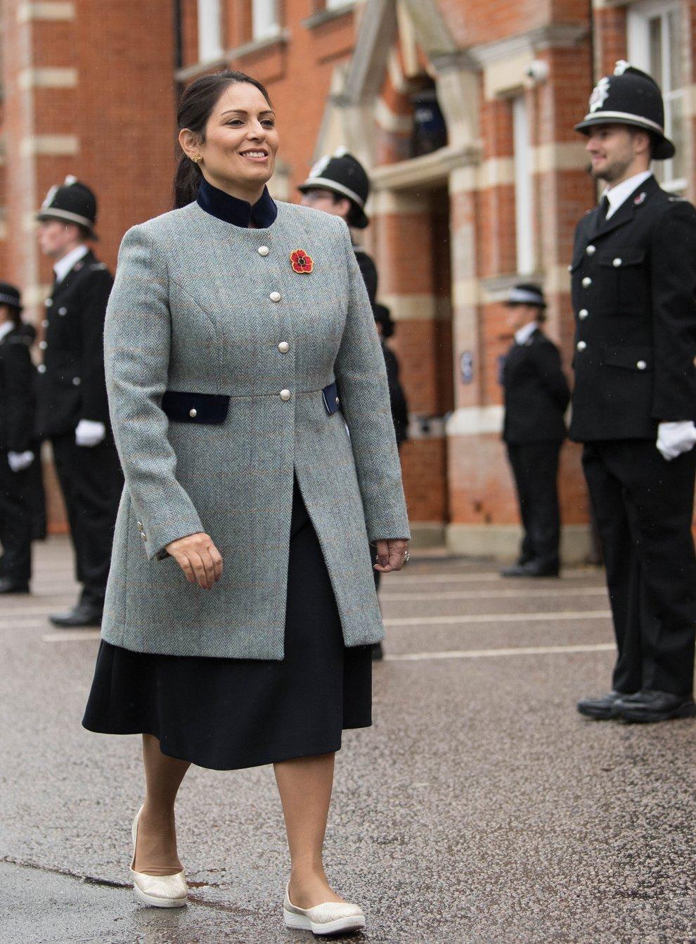 Home Secretary Priti Patel inspects new police recruits (Stefan Rousseau/PA)