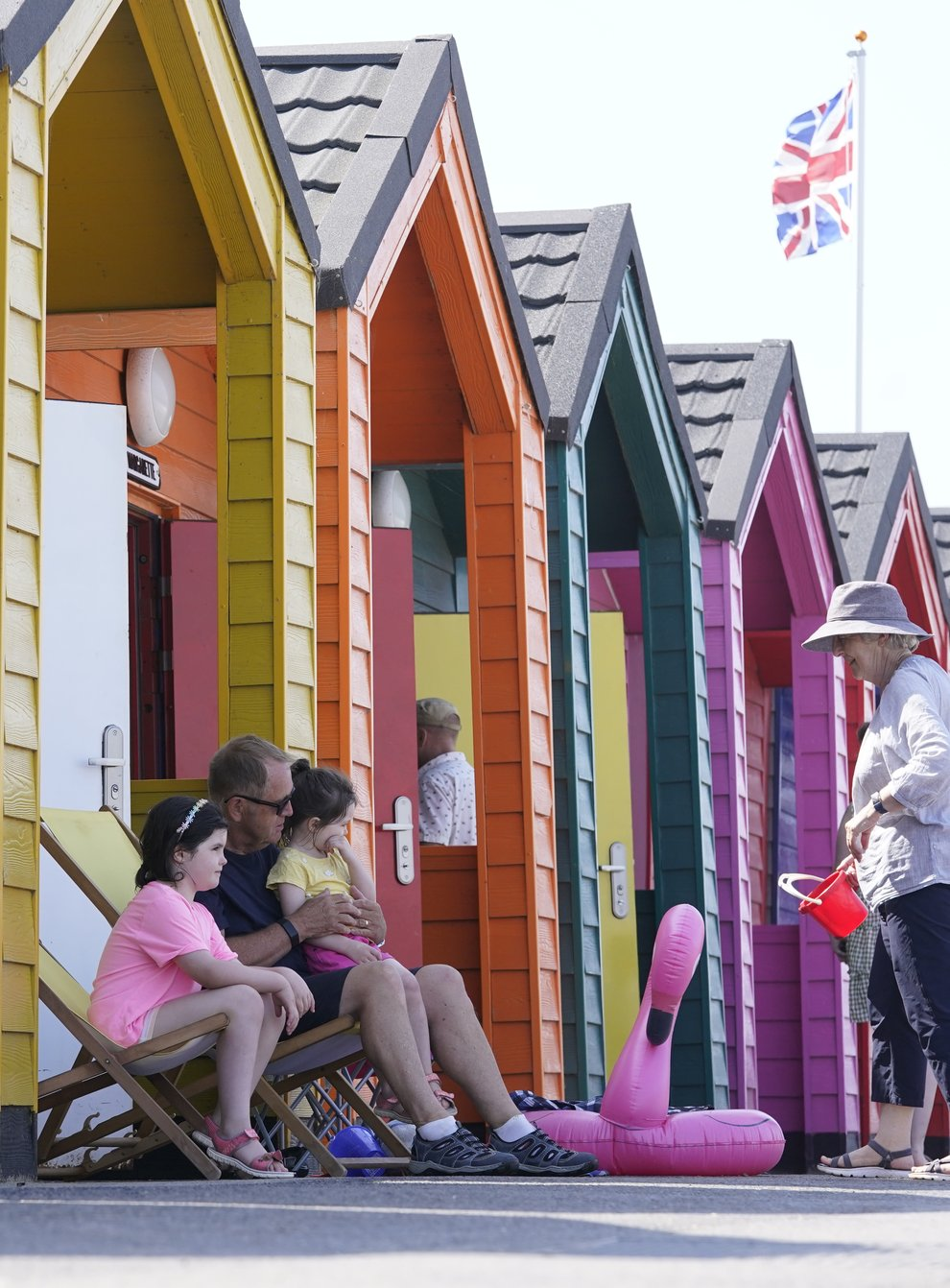 People by the beach at Saltburn-by-the-Sea in North Yorkshire. A heatwave which has baked the UK over the last few days is expected to end with thunderstorms across much of England and Wales this weekend, forecasters have warned. Picture date: Thursday July 22, 2021.