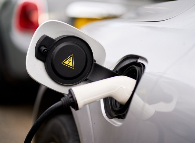 Electric car charging provision at motorway service areas, on local roads and in rural areas is inadequate, the competition regulator has warned (John Walton/PA)