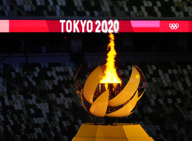 A view of the Olympic flame during the opening ceremony of the Tokyo 2020 Olympic Games (Martin Rickett/PA Images)