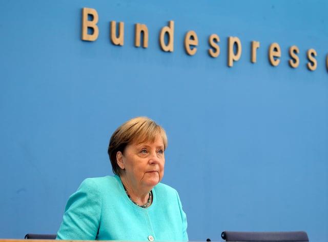 German Chancellor Angela Merkel holds her annual summer news conference in Berlin (Wolfgang Kumm/dpa/AP)