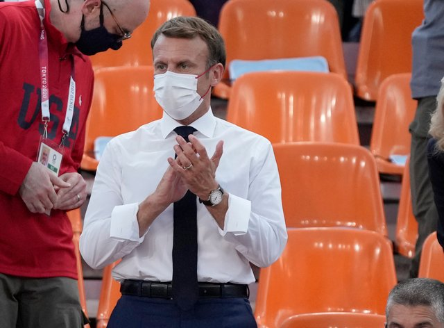 French President Emmanuel Macron applauds as he watches the Olympic basketball game between France and the US in Tokyo (Jeff Roberson/AP)
