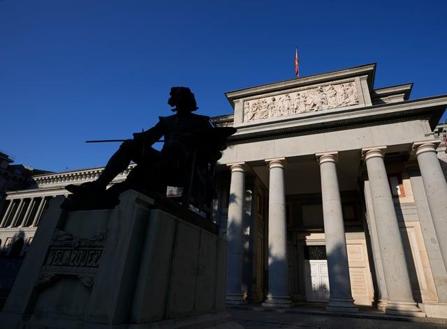 A statue of Spanish painter Diego Velazquez outside the Prado Museum on the Paseo del Prado boulevard (Paul White/AP)
