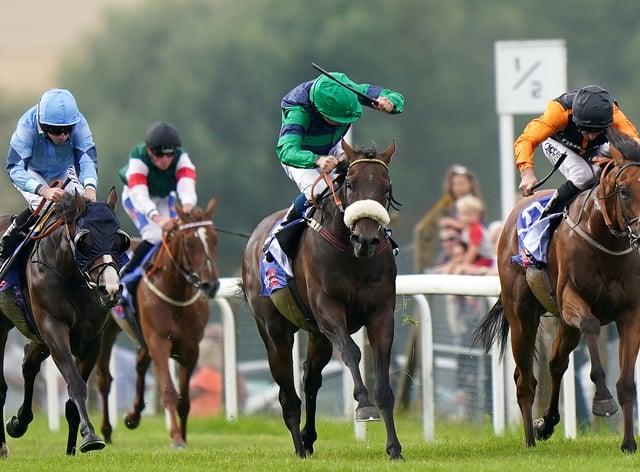 Brunch (centre, green) winning at Pontefract (Tim Goode/PA)