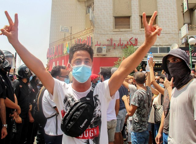 A protester in Tunis (AP)