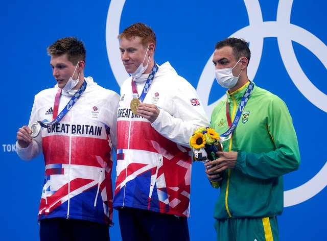 Tom Dean, centre, led a Great Britain one-two (Adam Davy/PA)