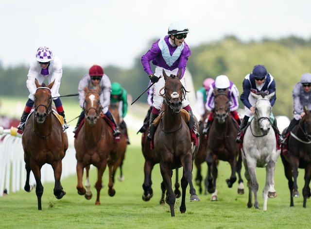 Alcohol Free and Oisin Murphy (centre) coming home to win the Qatar Sussex Stakes (John Walton/PA)