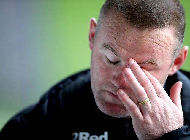 Images emerged showing Wayne Rooney asleep in a hotel room surrounded by a group of young women (Nick Potts/PA)