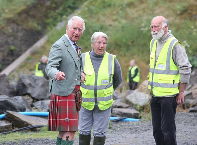The Prince of Wales wore a kilt as he met Dorcas and Allan Sinclair (Paul Campbell/PA)