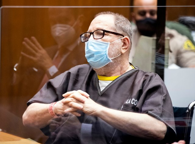 Harvey Weinstein wears a face mask as he listens in court during a pre-trial hearing in Los Angeles (Etienne Laurent/Pool Photo via AP)