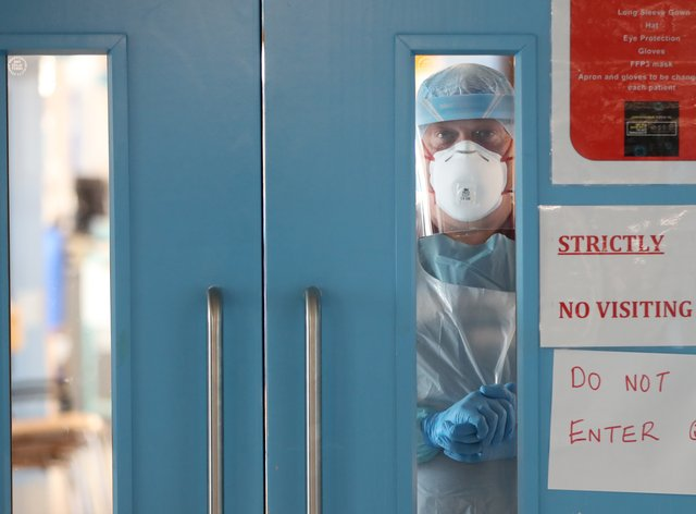 Infection control nurse Colin Clarke looking out from a Covid-19 recovery ward at Craigavon Area Hospital in Co Armagh (PA)