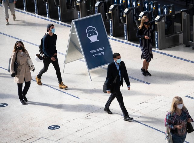 Passengers wearing face masks at Waterloo station in London (Victoria Jones/PA)