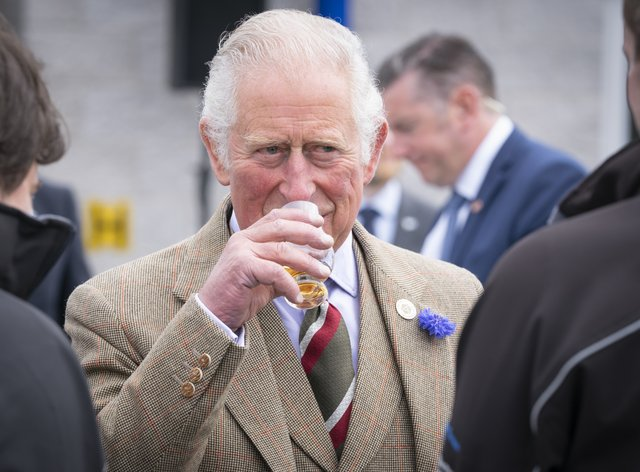 The Prince of Wales has a dram of whisky before officially opening the Lerwick Harbour and Scalloway fish markets (Jane Barlow/PA)