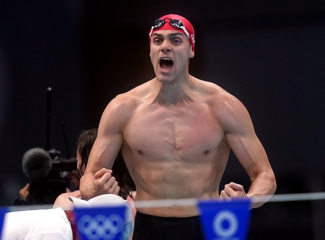 Great Britain's James Guy celebrates the gold medal in the mixed medley relay final (Adam Davy/PA)