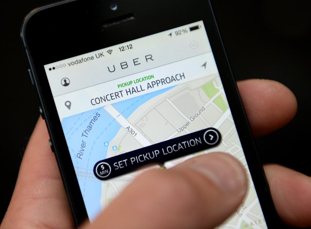 Uber will offer discounts to young adults who get a Covid jab (Andrew Matthews/PA)