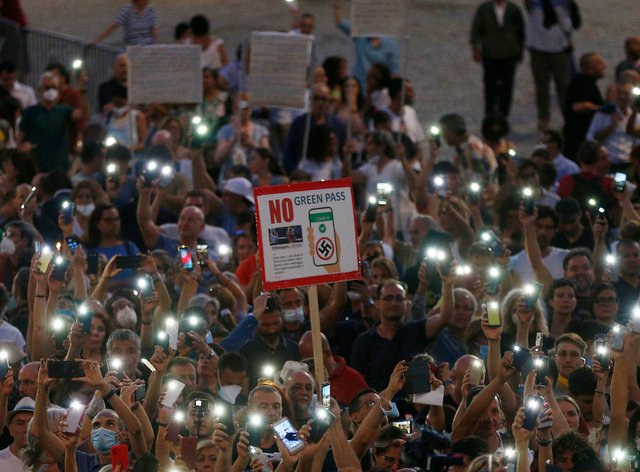 People stage a protest against the vaccination pass in Rome (Cecilia Fabiano/LaPresse via AP)