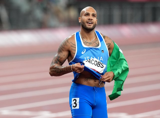 Italy's Lamont Jacobs celebrates winning gold in the men's 100 metres final (Martin Rickett/PA Images)