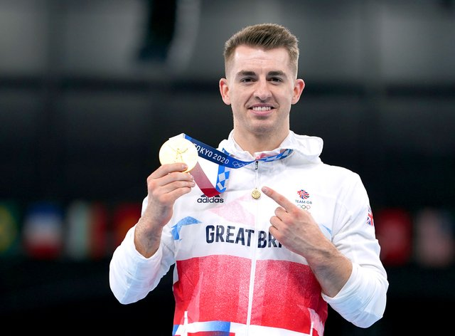 Great Britain's Max Whitlock celebrates with his gold medal after winning the men's pommel horse final in Tokyo (Mike Egerton/PA)