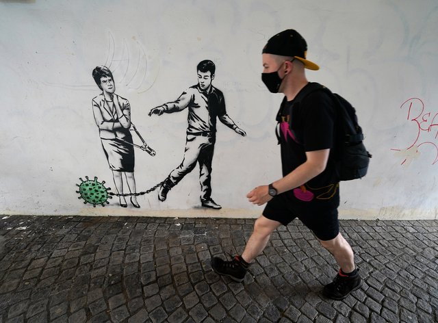 Street art by The Rebel Bear in Cannongate, Edinburgh, shows First Minister Nicola Sturgeon with a pair of bolt cutters (Andrew Milligan/PA)