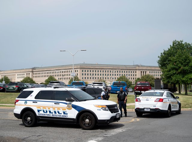 Police block off an entrance to the Pentagon following reports of multiple gun shots fired on a bus platform near the facility's Metro station Tuesday, Aug, 3 2021, in Washington. (AP Photo/Kevin Wolf)