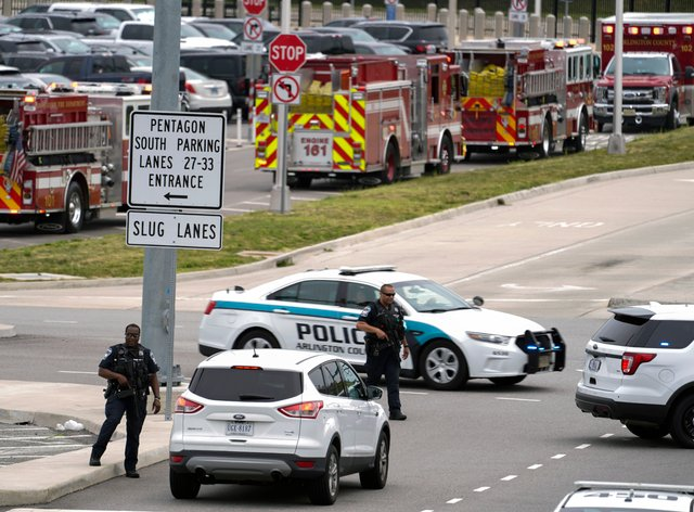 Emergency vehicles are seen outside the Pentagon Metro area Tuesday, Aug. 3, 2021, at the Pentagon in Washington. The Pentagon is on lockdown after multiple gunshots were fired near a platform by the facility's Metro station. (AP Photo/Andrew Harnik)