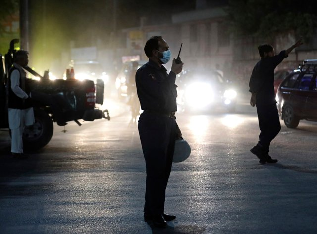 Afghan security personnel work at the site of a powerful explosion in Kabul, Afghanistan, Tuesday, Aug. 3, 2021. The explosion rocked a posh neighborhood of the Afghan capital where several senior government officials live. (AP Photo/Rahmat Gul)