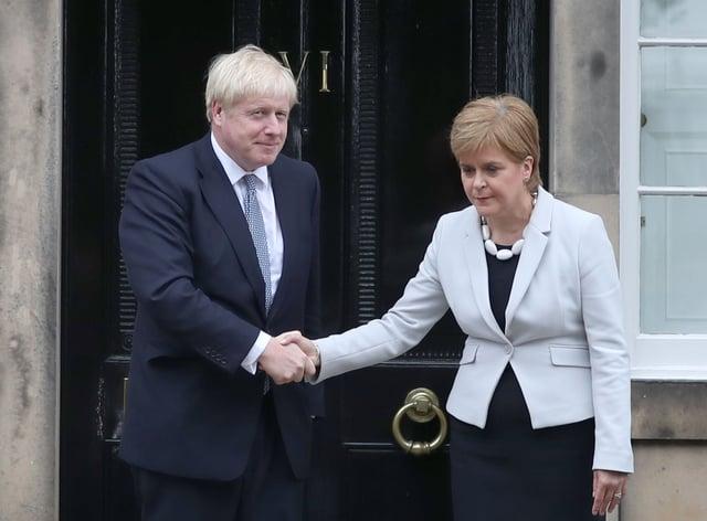 Nicola Sturgeon with Boris Johnson during a previous visit to Bute House (Jane Barlow/PA)