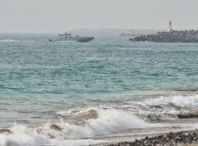 """An Emirati Coast Guard vessel patrols off Fujairah, United Arab Emirates, Wednesday, Aug. 4, 2021. The British navy warned of a """"potential hijack"""" of another ship off the coast of the United Arab Emirates in the Gulf of Oman near Fujairah on Tuesday, though the circumstances remain unclear. (AP Photo/Jon Gambrell)"""