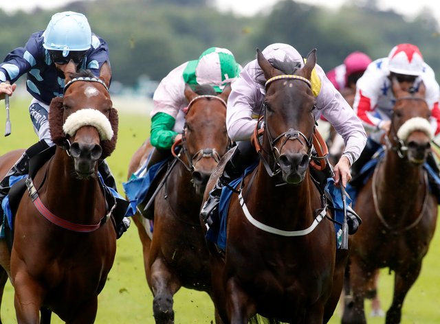 Moss Gill (centre) in winning action at York (Dan Abraham/PA)