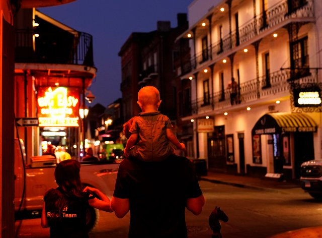 In the aftermath of Hurricane Ida, a family walks down Bourbon Street in the French Quarter of New Orleans (Matt Slocum/AP)