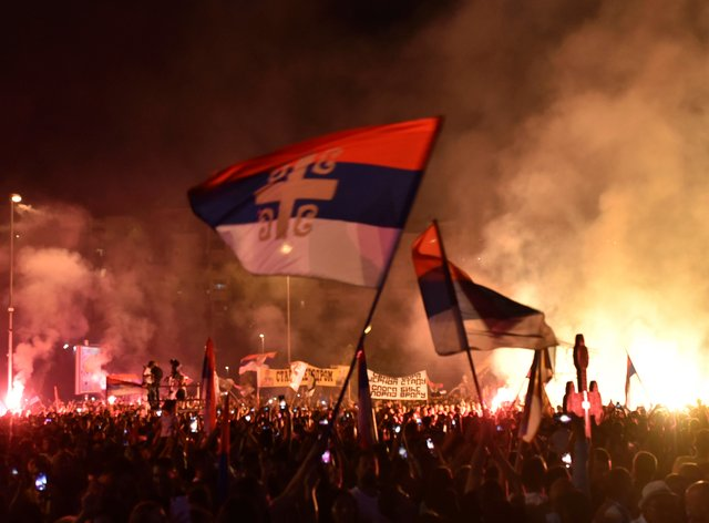 Hundreds of protesters confronted police in Cetinje ahead of the inauguration of Mitropolitan Joanikije as head of the Serbian Orthodox Church in Montenegro (Risto Bozovic/AP)