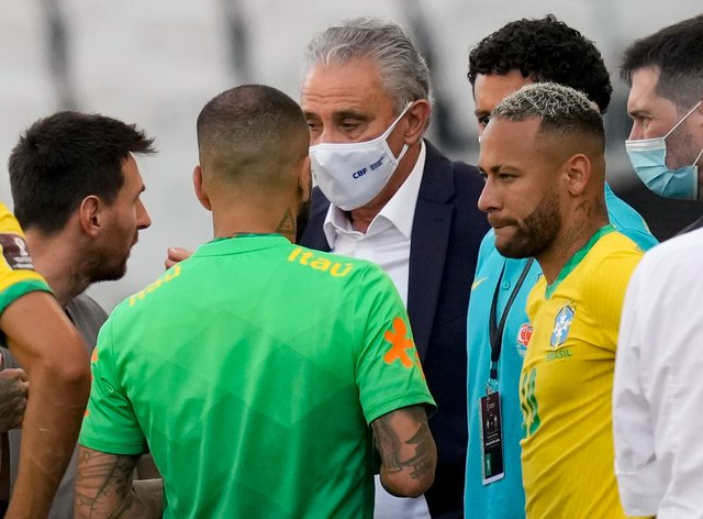 Argentina's Lionel Messi, left, talks to Brazil's coach Tite and Neymar during the incident in Sao Paulo (Andre Penner/AP)