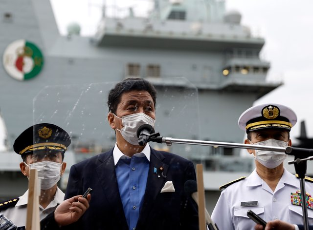 Japan Defence Minister Nobuo Kishi speaks to the media after inspecting HMS Queen Elizabeth (Kiyoshi Ota/Pool Photo via AP)