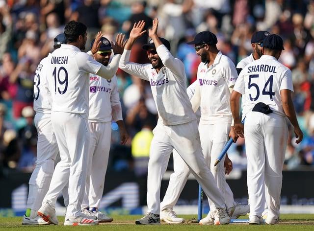 India players celebrate winning the Test (Adam Davy/PA)