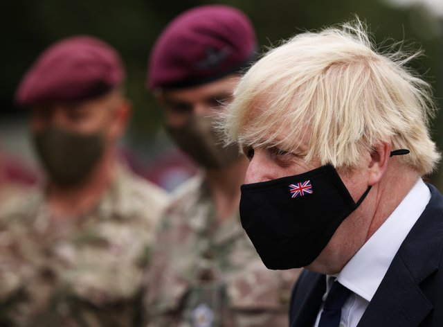 Prime Minister Boris Johnson with members of 16 Air Assault Brigade, following their deployment to Afghanistan (Dan Kitwood/PA)