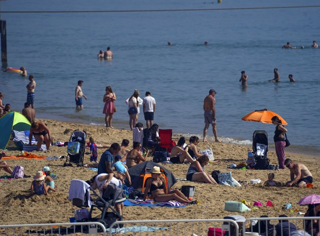 People enjoy the warm weather on Bournemouth Beach in Dorset (Steve Parsons/PA)