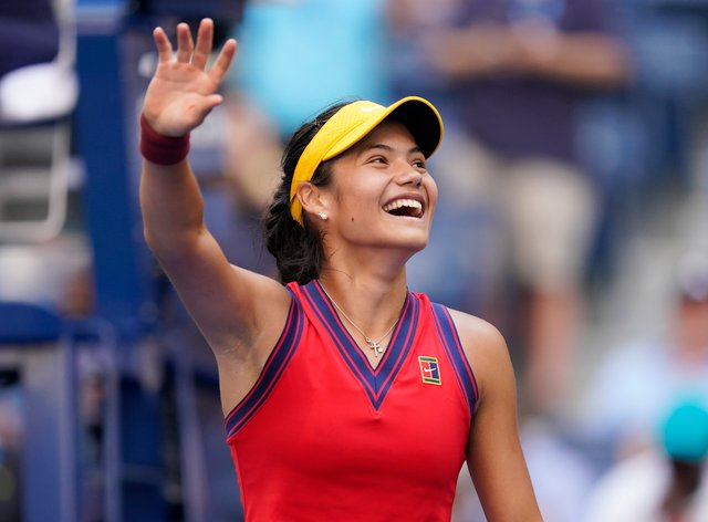 <p>Emma Raducanu soaks in her victory over Shelby Rogers (Seth Wenig/AP)</p>