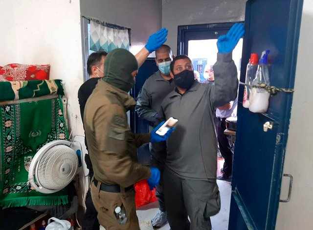 Israeli security personnel inspect a cell after six Palestinians escaped through a tunnel the Gilboa prison in north Israel (Israel Prison Service/AP)