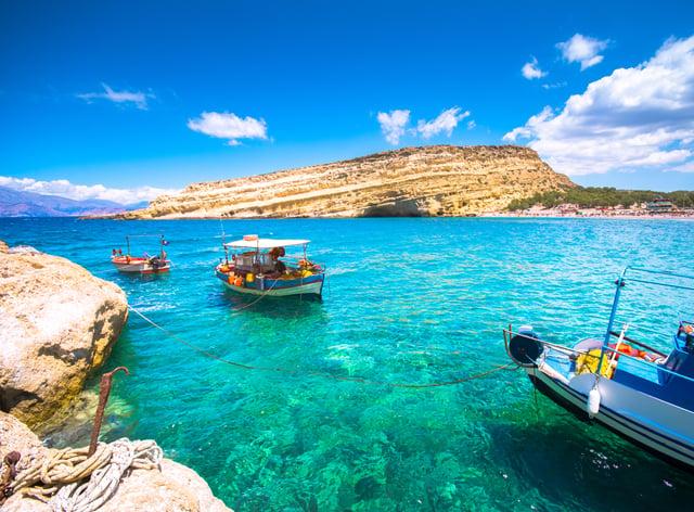 Matala beach in Crete (Alamy/PA)