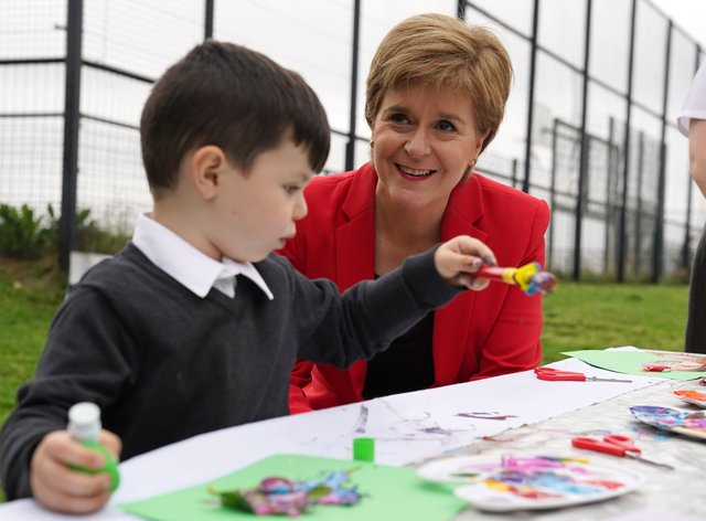 Nicola Sturgeon said her 'firm intention' was to increase the Scottish Child Payment 'sooner rather than later' (Andrew Milligan/PA)