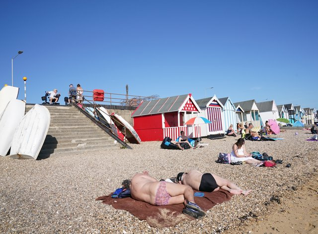 People enjoy the warm weather on the beach at South End on Sea, Essex (Stefan Rousseau/PA)