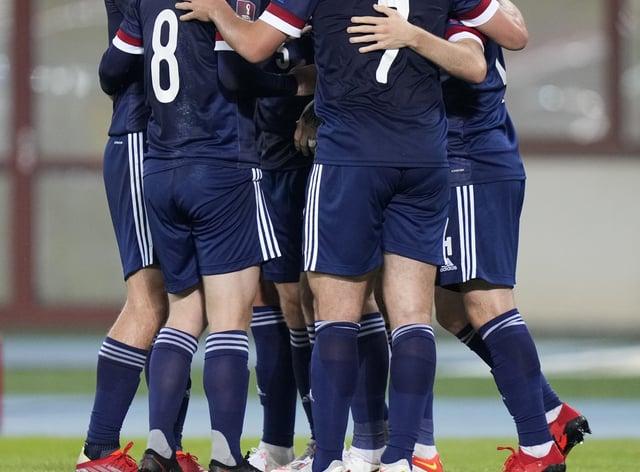 Scotland celebrate Lyndon Dykes' goal (Florian Schrotter/PA)