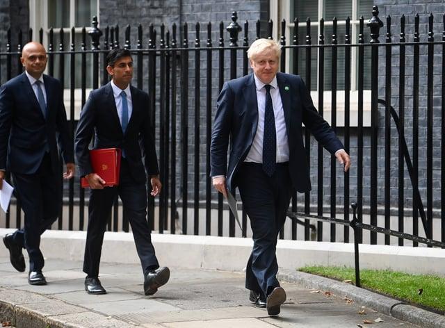 Health Secretary Sajid Javid, Chancellor of the Exchequer Rishi Sunak and Prime Minister Boris Johnson (Toby Melville/PA)