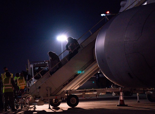British nationals and Afghan arrive on a flight from Afghanistan at RAF Brize Norton (Jacob King/PA)