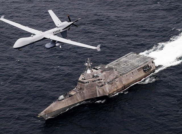 An MQ-9 Sea Guardian unmanned maritime surveillance drone flies over the USS Coronado (US Navy/Chief Mass Communication Specialist Shannon Renfroe, via AP)