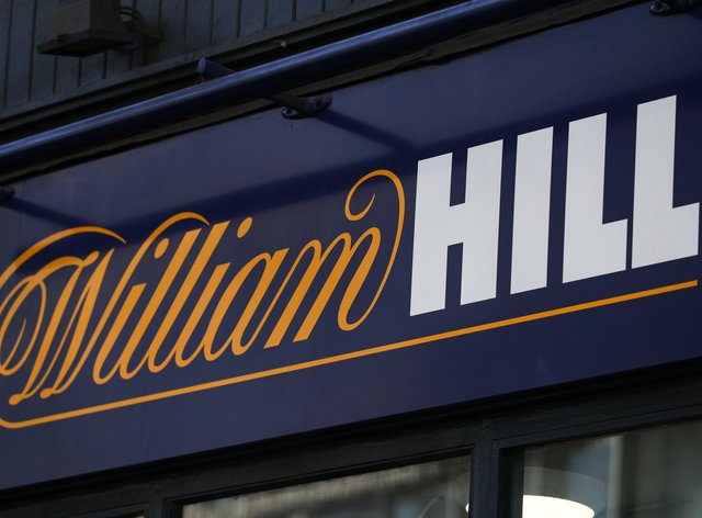 Online gambling group 888 has agreed a £2.2 billion deal to buy William Hill's European business and its 1,400 UK betting shops in a move that will see it return to British hands (PA)
