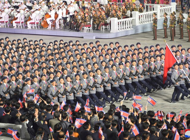 North Korean troops parade during a celebration of the nation's 73rd anniversary that was overseen by leader Kim Jong Un (Korean Central News Agency/AP)