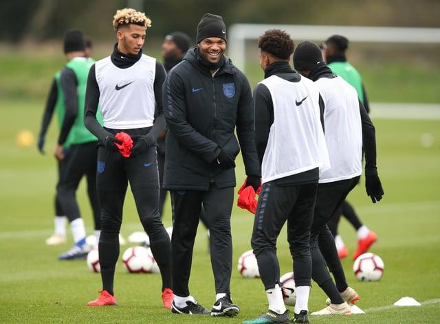 Joleon Lescott, centre, is part of England's Under-21 coaching set-up (Andrew Matthews/PA)